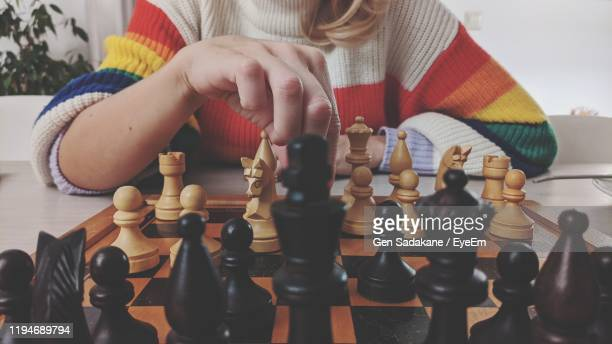 midsection of woman playing chess - chess stock pictures, royalty-free photos & images
