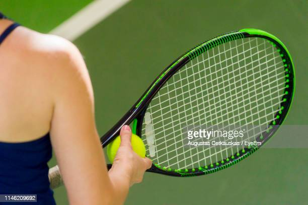 midsection of woman playing tennis - tennis racquet stock pictures, royalty-free photos & images