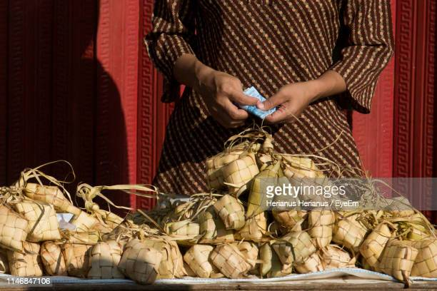 Midsection Of Woman Selling Food In Market