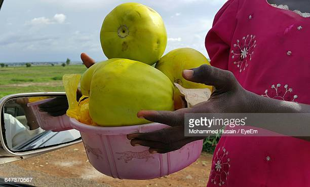 midsection of woman selling fruit - nigerian food stock pictures, royalty-free photos & images