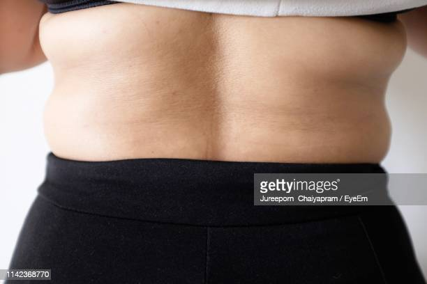 midsection of woman showing back - human back stock photos and pictures