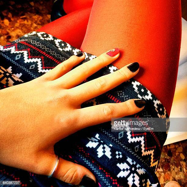 midsection of woman showing nail polish - black nail polish stock photos and pictures