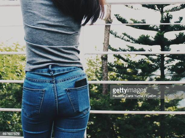 Midsection Of Woman Standing On Against Trees