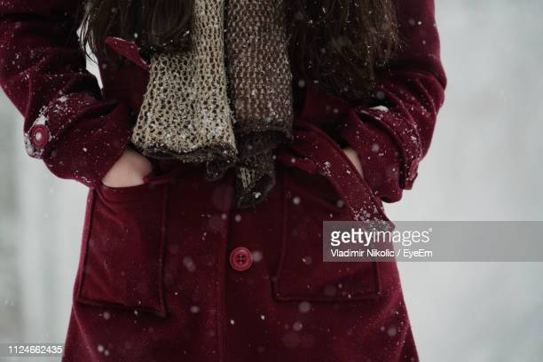 midsection of woman standing with hands in pockets - hands in pockets stock pictures, royalty-free photos & images
