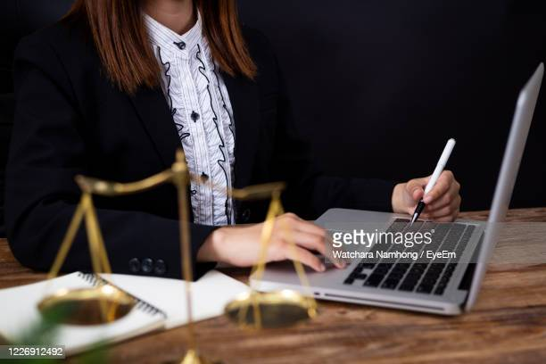 midsection of woman using laptop - court room stock pictures, royalty-free photos & images
