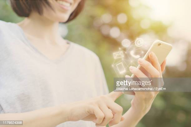 midsection of woman using mobile phone - wikipedia:contact_us stock pictures, royalty-free photos & images