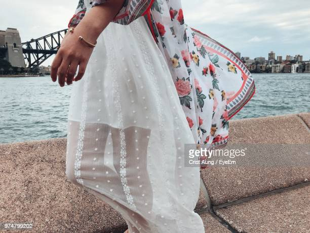 midsection of woman walking on promenade - shawl stock pictures, royalty-free photos & images