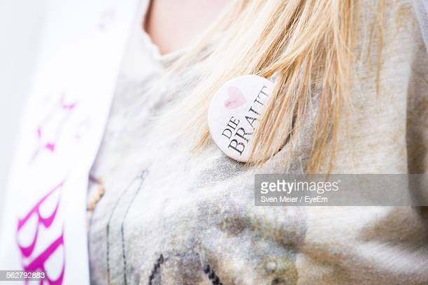 Midsection Of Woman Wearing Badge