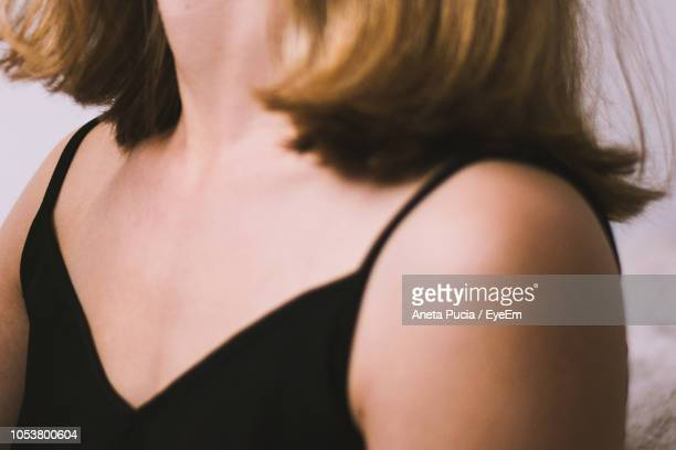 Midsection Of Woman Wearing Black Clothing