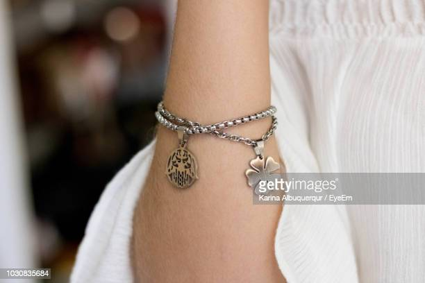 midsection of woman wearing bracelet - pendant stock pictures, royalty-free photos & images
