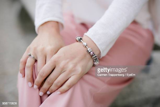 midsection of woman wearing bracelet - bracelet stock pictures, royalty-free photos & images