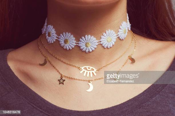midsection of woman wearing choker and necklaces - short necklace stock pictures, royalty-free photos & images