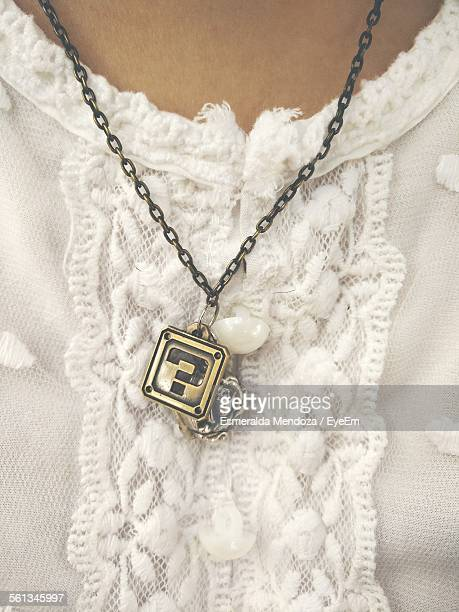 Midsection Of Woman Wearing Necklace