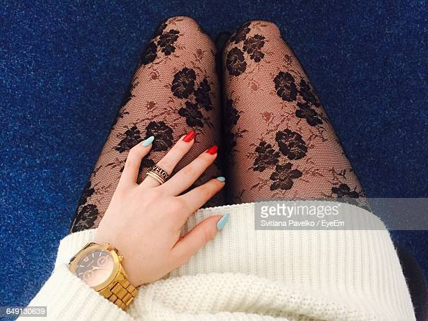 Midsection Of Woman Wearing Netting Stockings