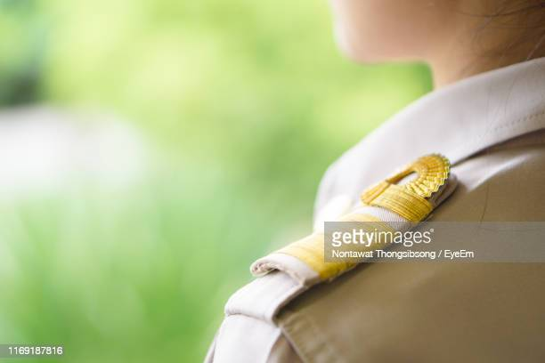 midsection of woman wearing police uniform - police uniform stock pictures, royalty-free photos & images
