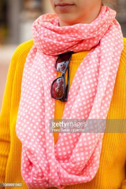 midsection of woman wearing sweater and scarf with sunglasses in city - florin seitan stock pictures, royalty-free photos & images
