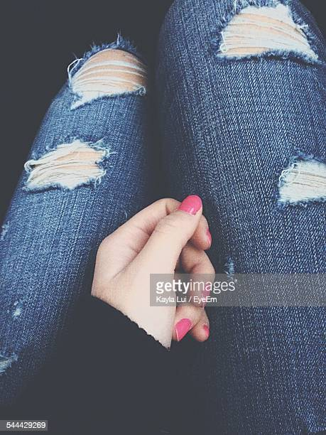 Midsection Of Woman Wearing Torn Jeans