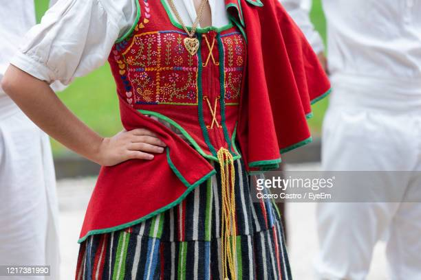 midsection of woman wearing traditional clothing while standing outdoors - funchal stock pictures, royalty-free photos & images