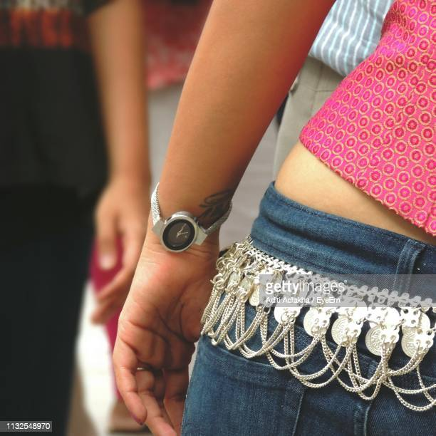 Midsection Of Woman Wearing Wristwatch