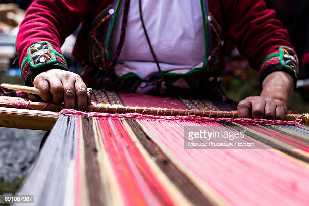 Midsection Of Woman Weaving Alpaca Wool