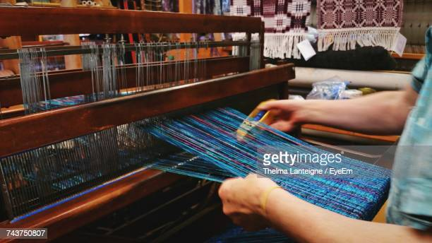 midsection of woman weaving looms with shuttle at workshop - mid section stock pictures, royalty-free photos & images