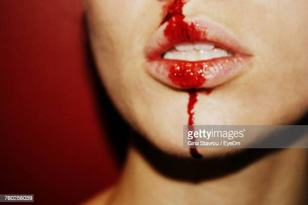 Midsection Of Woman With Blood On Mouth