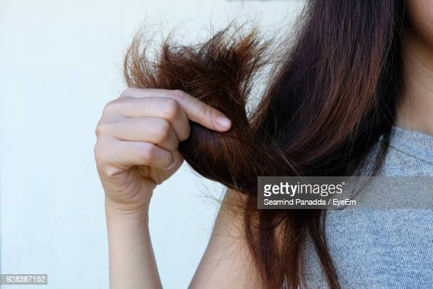 Midsection Of Woman With Brown Hair