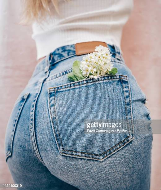 midsection of woman with flowers in pocket - fanny pic stock pictures, royalty-free photos & images