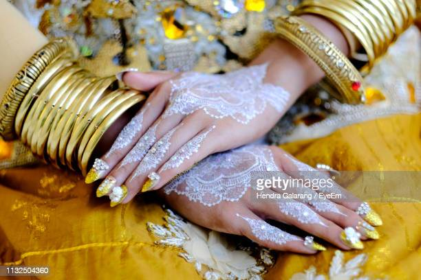 Midsection Of Woman With Heena Tattoo On Hands