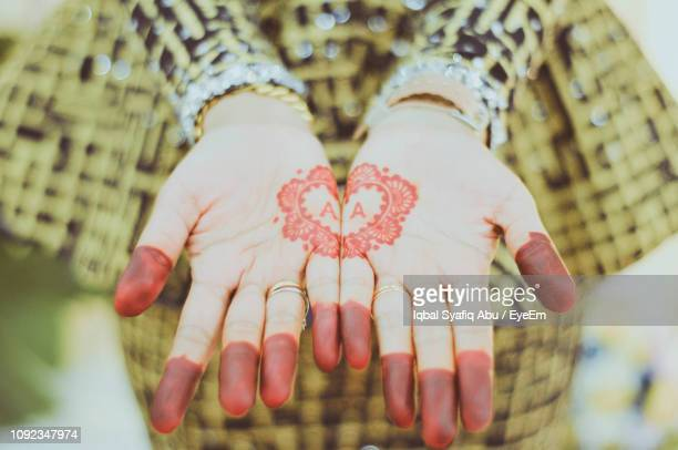 midsection of woman with henna tattoo on hands - tattoo designs hearts stock pictures, royalty-free photos & images