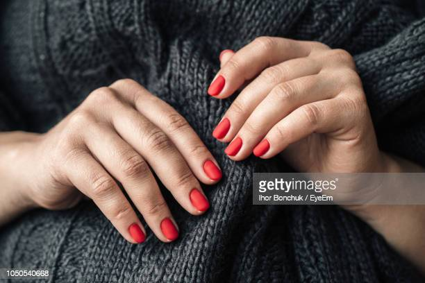 midsection of woman with red painted nails - fingernail stock pictures, royalty-free photos & images