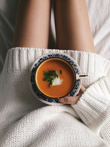 Midsection Of Woman With Soup At Home - gettyimageskorea