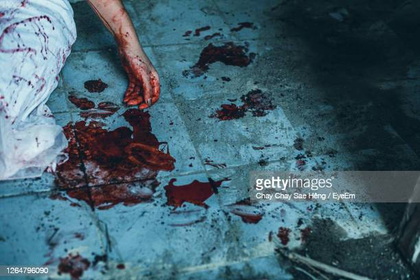 midsection of woman with stained hand - murder stock pictures, royalty-free photos & images