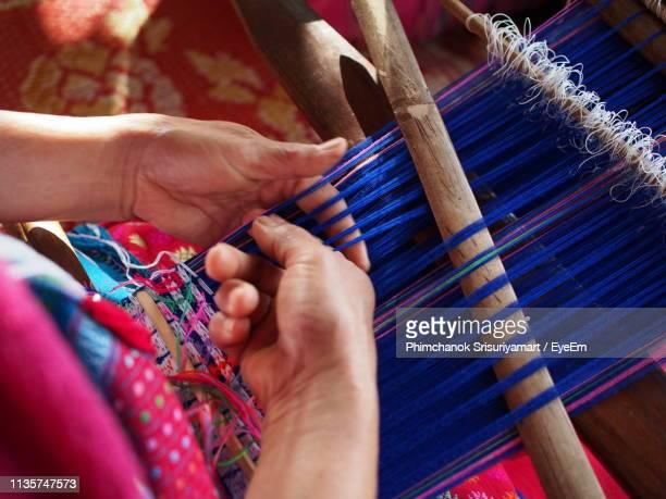midsection of woman working on loom - loom stock pictures, royalty-free photos & images
