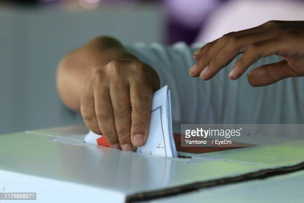 midsection of woman working on table - voter registration stock pictures, royalty-free photos & images