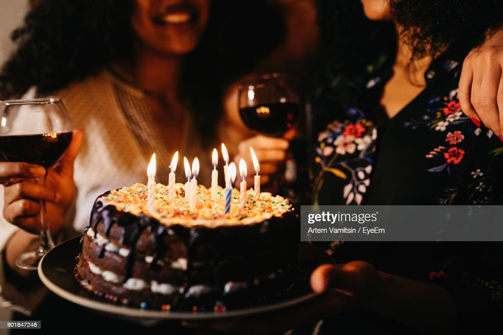 Excellent Midsection Of Women With Birthday Cake In Darkroom High Res Stock Birthday Cards Printable Benkemecafe Filternl