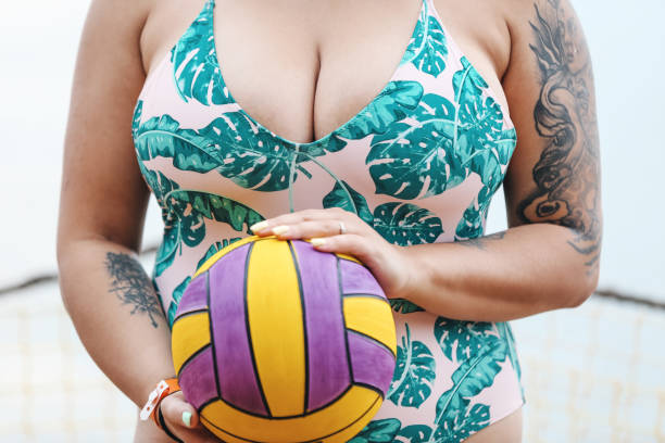 Midsection Of Young Beautiful Woman In Swimwear With Water Polo Ball