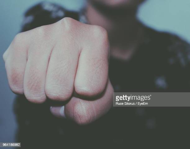 midsection of young woman showing fist - punching stock pictures, royalty-free photos & images