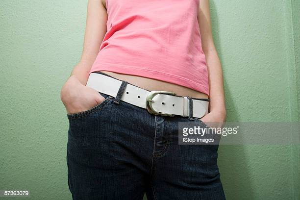 Midsection view of young woman in casual clothing