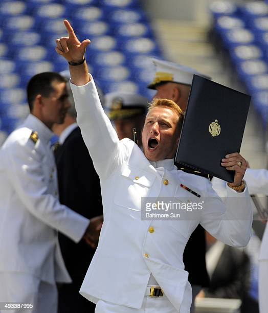 Midshipman Christopher Junghans of Dunkirk Md reacts after receiving his diploma at the United States Naval Academy graduation and commissioning...