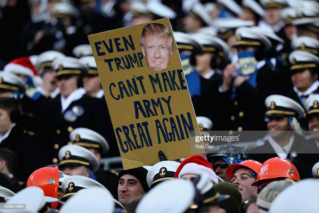 A Midshipmen holds up a sign during the Navy Midshipmen and Army Black Knights game at M&T Bank Stadium on December 10, 2016 in Baltimore, Maryland.