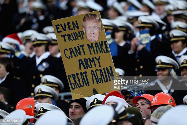 Midshipmen holds up a sign during the Navy Midshipmen and Army Black Knights game at MT Bank Stadium on December 10 2016 in Baltimore Maryland