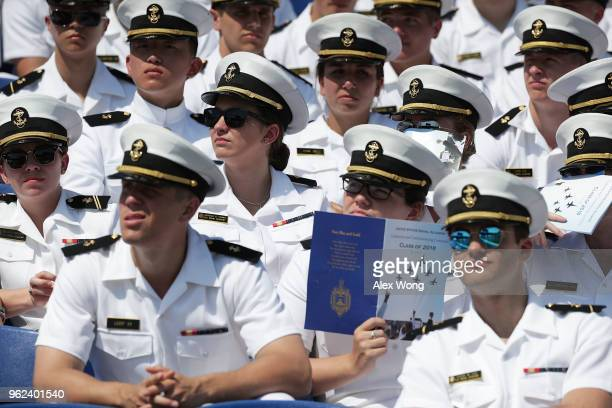 Midshipmen listen during a graduation ceremony at the NavyMarine Corps Memorial Stadium of the US Naval Academy May 25 2018 in Annapolis Maryland...
