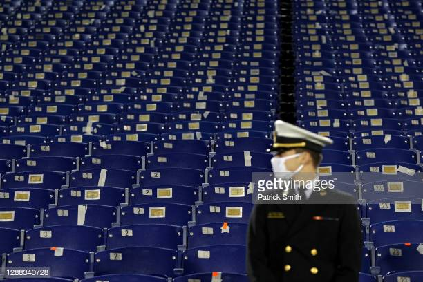 Midshipmen looks on as spectator seating is seen empty behind him as the Memphis Tigers play against the Navy Midshipmen during the first half at...
