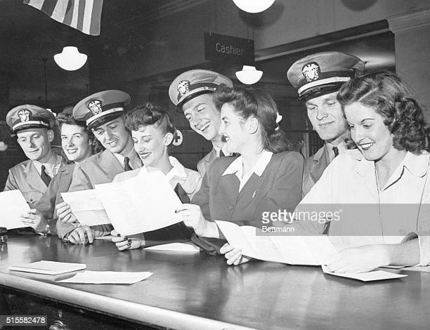 Midshipmen, who may not marry until they are commissioned as ensigns, jam the Chicago marriage license bureau in anticipation of their graduation...