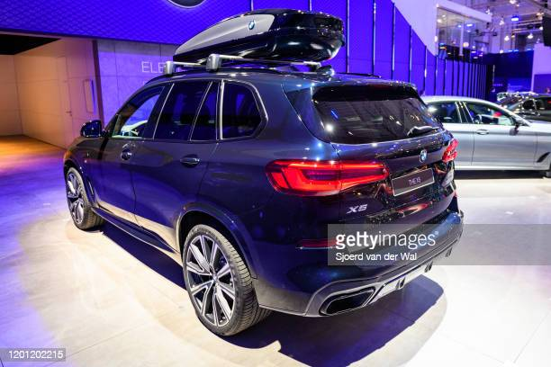 X5 midsize luxury SUV with matching skibox on display at Brussels Expo on January 9 2020 in Brussels Belgium The BMW X5 is available with various...