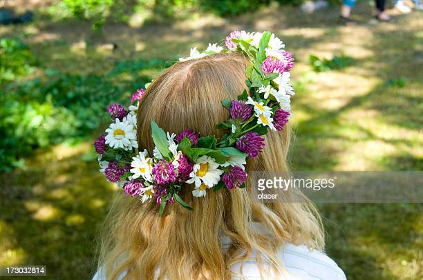 Midsommer girl with flowers in her hair