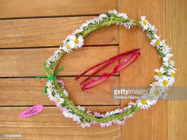 midsummer accessories on a garden table - girdle stock pictures, royalty-free photos & images