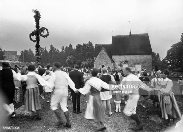 Midsummer Feast Day children and members of folk dance clubs and society for traditional costumes dancing