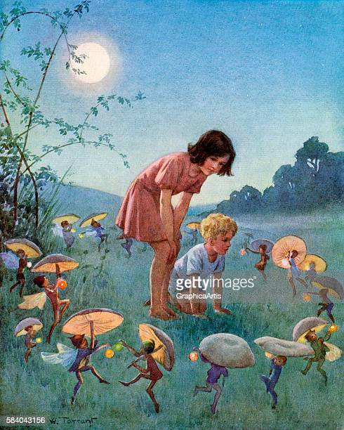 Midsummer Night with a boy and girl on the edge of the forest watching fairies dance with mushroom umbrellas 1920 Screen print